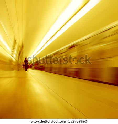 Train in motion blur and blurred people on background. - stock photo