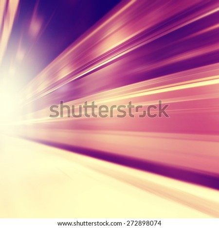 Train in motion blur in subway station. - stock photo
