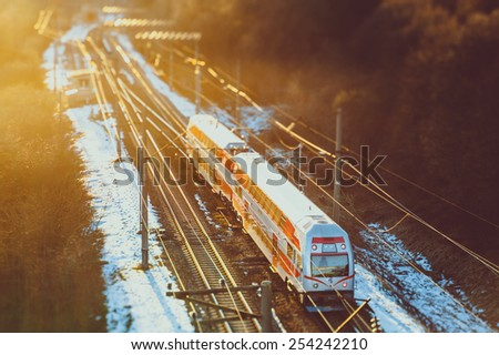 Train in sunset, winter time, selective focus - stock photo
