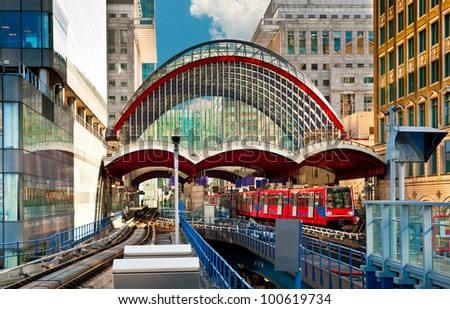 Train leaves Canary Wharf docklands station in London - stock photo