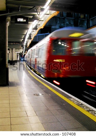 Train leaving a London Underground station - stock photo