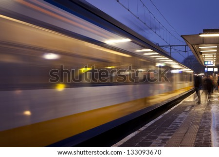 Train leaving train station - stock photo