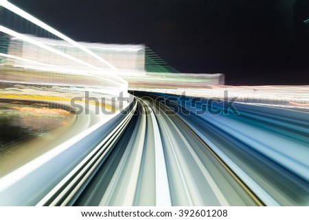 Train moving fast at night - stock photo