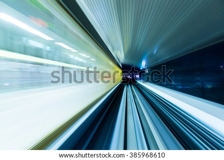 Train moving fast in tunnel - stock photo