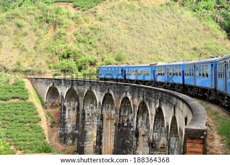 Train on bridge in hill country of Sri Lanka - stock photo