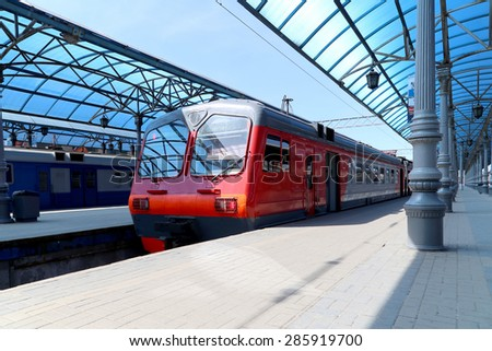Train on Moscow passenger platform (Yaroslavsky railway station), Russia-- is one of nine main railway stations in Moscow, situated on Komsomolskaya Square.  - stock photo