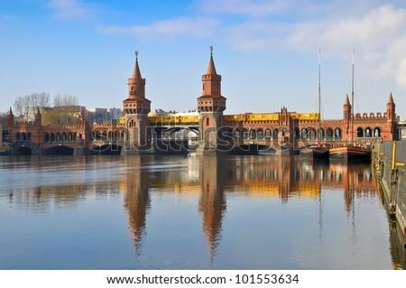 train on oberbaum bridge in berlin, germany - stock photo