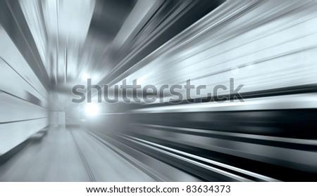 Train on speed in railway station - stock photo