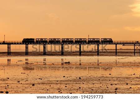Train on the Southend Pier at sunset, Southend-on-Sea, Essex, England