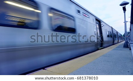 Train Passes in a Blur, Low-Angle View