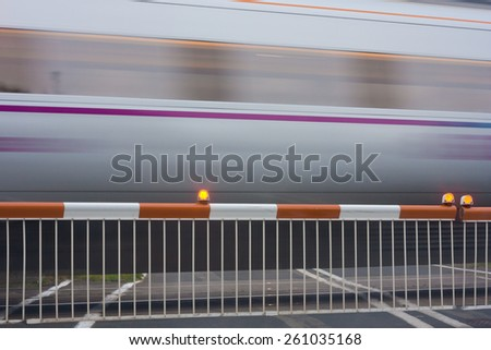 train passing level crossing - stock photo
