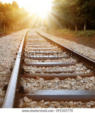 Train rail sunset  - stock photo