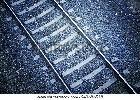 Train routes, detail of train tracks at a station in the city, textured background, transportation