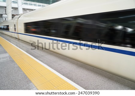 Train station and train in motion blur