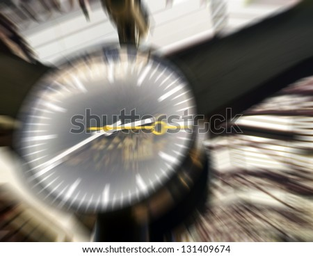 Train station clock in motion blur - stock photo