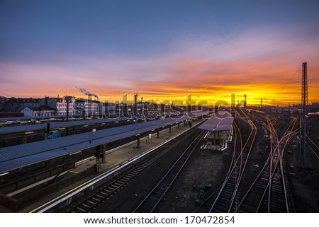 Train station for local and regional trains in Berlin Lichtenberg at sunset with colorful sky.