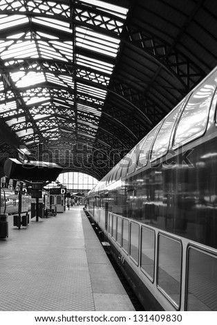Train station in black and white - stock photo