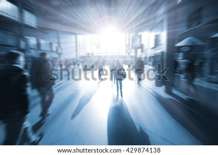 train station in the rush hour is made in the manner of blur and a blue tonality