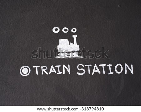Train station sign draw on black cement wall. - stock photo
