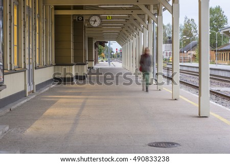 Train station with a busy lady