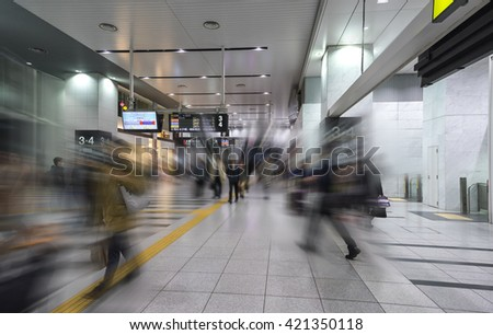 Train station with Blurred motion passengers - stock photo