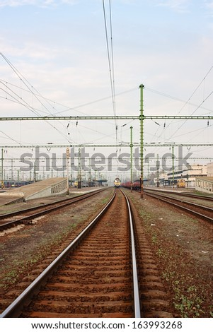 Train station with departing train - stock photo