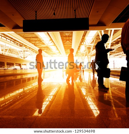 train stop at railway station with sunset - stock photo