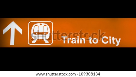 Train to city orange  sign - stock photo