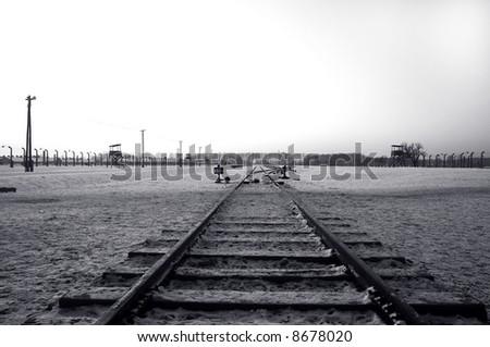 Train Track in Auschwitz / Birkenau Concentration Camp - stock photo