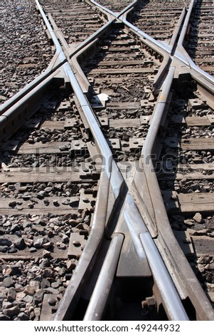 Train track rail road crossing - stock photo