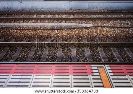 Train track railroad and waiting path, horizontal view