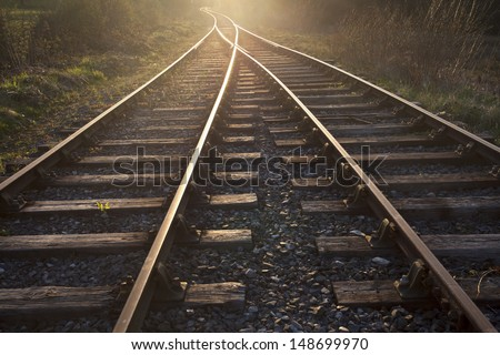 train tracks at sunset - stock photo