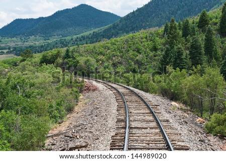 Train tracks curving along a mountain pass near La Veta, Colorado - stock photo