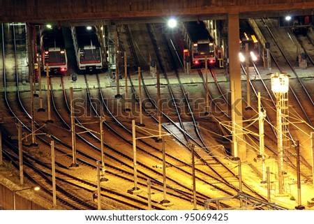 Train tracks in hongkong by night. - stock photo