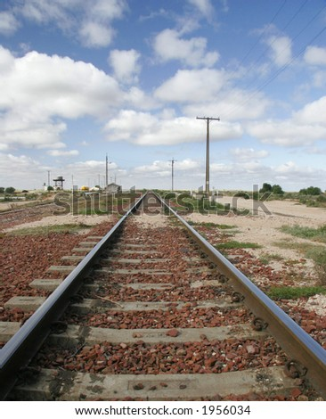 Train tracks in the outback in Aussie land. - stock photo