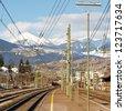 Train tracks leading to the Alps, South Tyrol, Italy. - stock photo