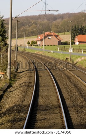Train tracks with house - stock photo