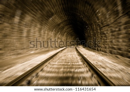 train tunnel with motion blur effect - stock photo