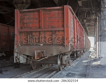 Train under loading of coal at a coal mine - stock photo