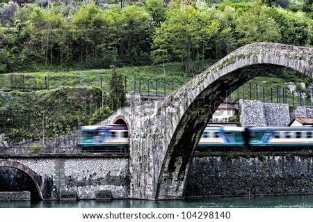 train under the devil's bridge - stock photo