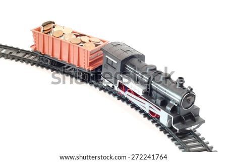 Train with money isolated on white background - stock photo