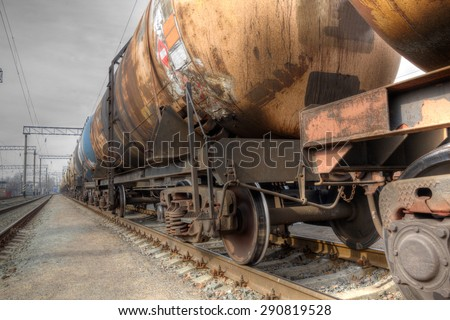 Train with oil railway cisterns on the track  - stock photo