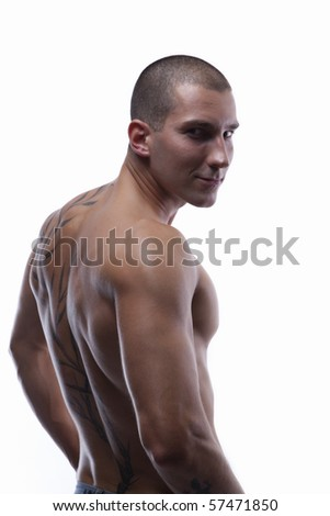 Trained male's back with tattoo - stock photo