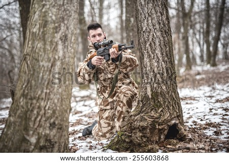 trained trooper performing military operation during winter war - stock photo