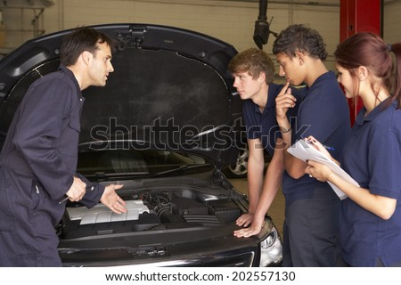 Trainee mechanics at work - stock photo