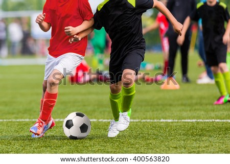 Training and football match between youth soccer teams. Young boys playing soccer game.  - stock photo