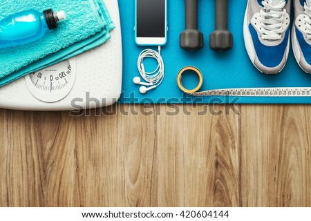 Training and sports equipment on a mat and weight scale, healthy lifestyle and workout concept, flat lay banner - stock photo
