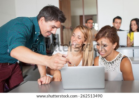 Training at laptop - stock photo