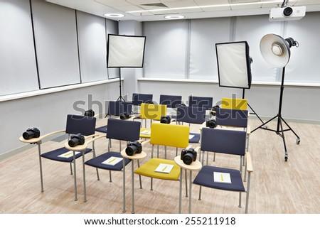 Training class in modern photography school - stock photo