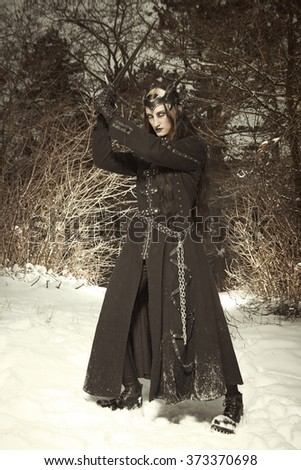 Training dark princess in winter forest - stock photo